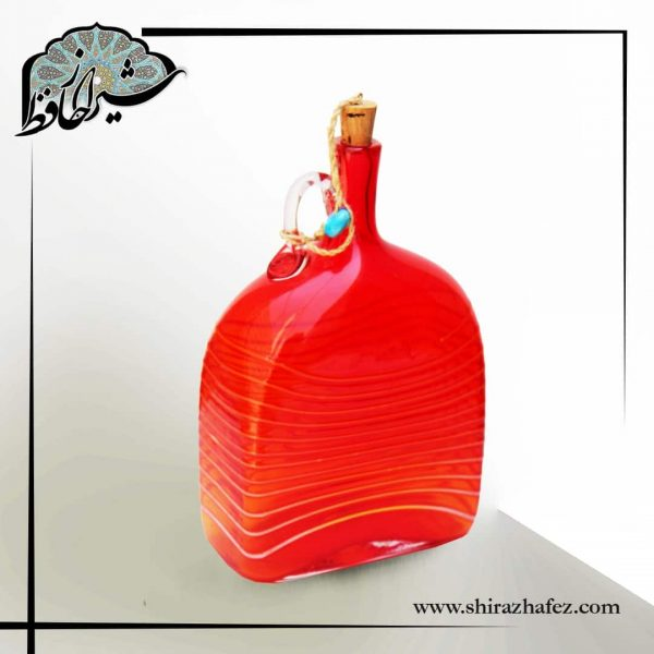 بطری مستطیل شکل رنگی شیشه ای با در پوش چوب پنبه ، مناسب برای انواع دکوراسیون و استفاده کاربردی . خرید از فروشگاه انلاین شیراز حافظ .