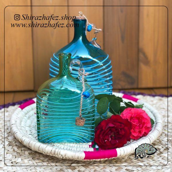 بطری مستطیل بزرگ آبی ساخته شده از شیشه و کریستال ،خرید آنلاین صنایع دستی سرامیکی در فروشگاه آنلاین صنایع دستی شیراز حافظ . عرضه کننده محصولات دکوراتیو شیشه
