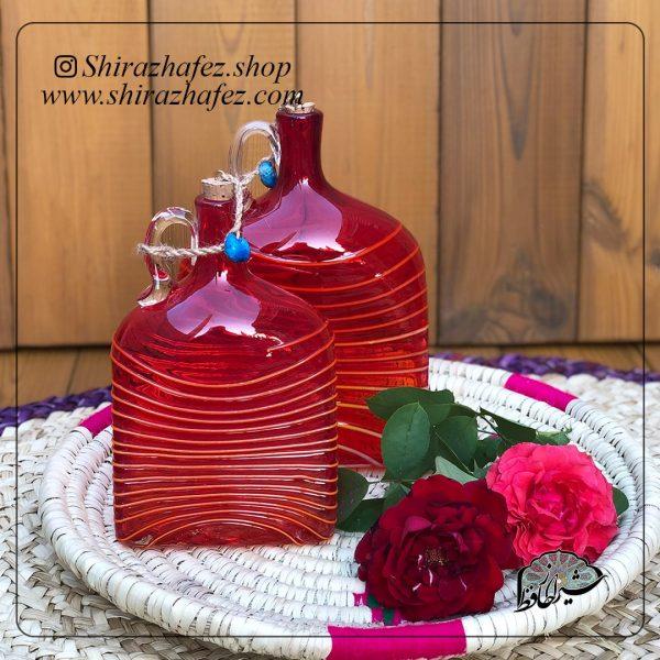 بطری مستطیل قرمز کوچک ساخته شده از شیشه و کریستال ،خرید آنلاین صنایع دستی سرامیکی در فروشگاه آنلاین صنایع دستی شیراز حافظ . عرضه کننده محصولات دکوراتیو شیشه