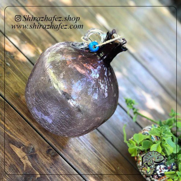 بطری انار متوسط بنفش ساخته شده از شیشه و کریستال ،خرید آنلاین صنایع دستی شیشه ای در فروشگاه آنلاین صنایع دستی شیراز حافظ .عرضه کننده محصولات دکوراتیو شیشه ای