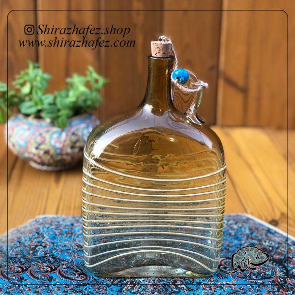 بطری نگینی عسلی ساخته شده از شیشه و کریستال ،خرید آنلاین صنایع دستی شیشه ای در فروشگاه آنلاین صنایع دستی شیراز حافظ . عرضه کننده محصولات دکوراتیو شیشه ای