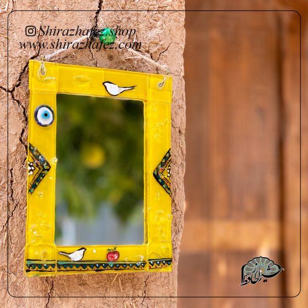 آینه همجوشی کد12، محصولی فانتزی و زیبا از صنایع دستی ایران که از هنر همجوشی شیشه پدید آمده است .آینه هم جوشی میتوتن هم به صورت دیوارکوب و هم رومبزی