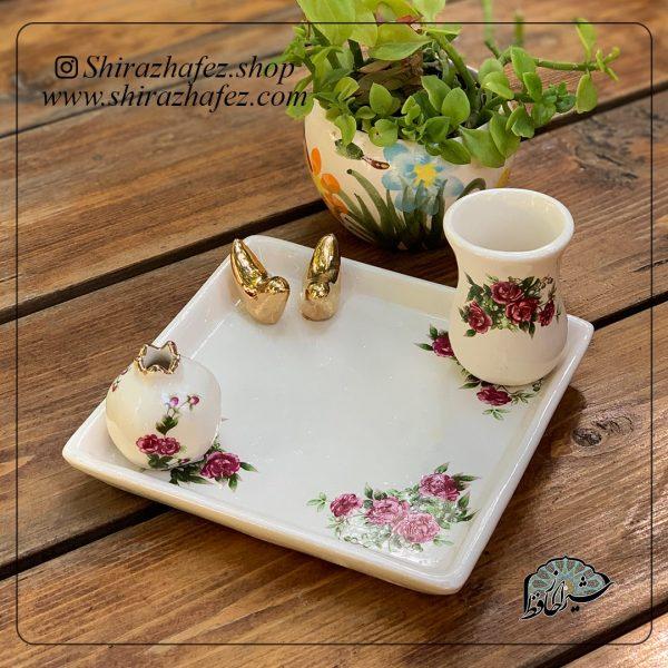 ست سرامیکی گل سرخی ساخته شده از سفال و سرامیک ،خرید آنلاین صنایع دستی سرامیکی در فروشگاه آنلاین صنایع دستی شیراز حافظ . عرضه کننده محصولات دکوراتیو