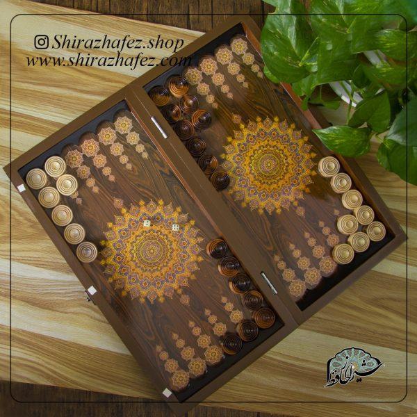 تخته نرد 50سانتی کد 03 طرح ستاره ای نمونه ای از انواع تخته نرد های موجود در فروشگاه اینترنتی شیراز حافظ می باشد که شما علاقه مندان می توانید با