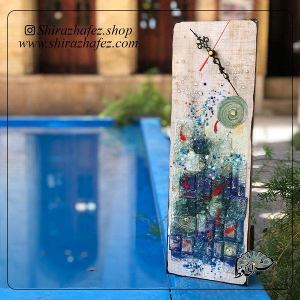 ساعت هم جوشی کد 09 ، محصولی فانتزی و زیبا از صنایع دستی ایران که از هنر همجوشی شیشه پدید آمده است .ساعت دیواری هم جوشی شیشه از شکل دهی و رنگ آمیزی