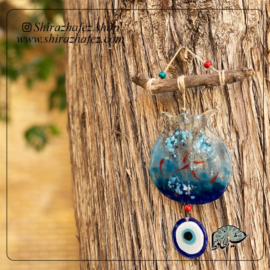 آویز هم جوشی چشم نظر ، محصولی فانتزی و زیبا از صنایع دستی ایران که از هنر همجوشی شیشه پدید آمده است .آویز هم جوشی چشم نظر همجوشی شیشه