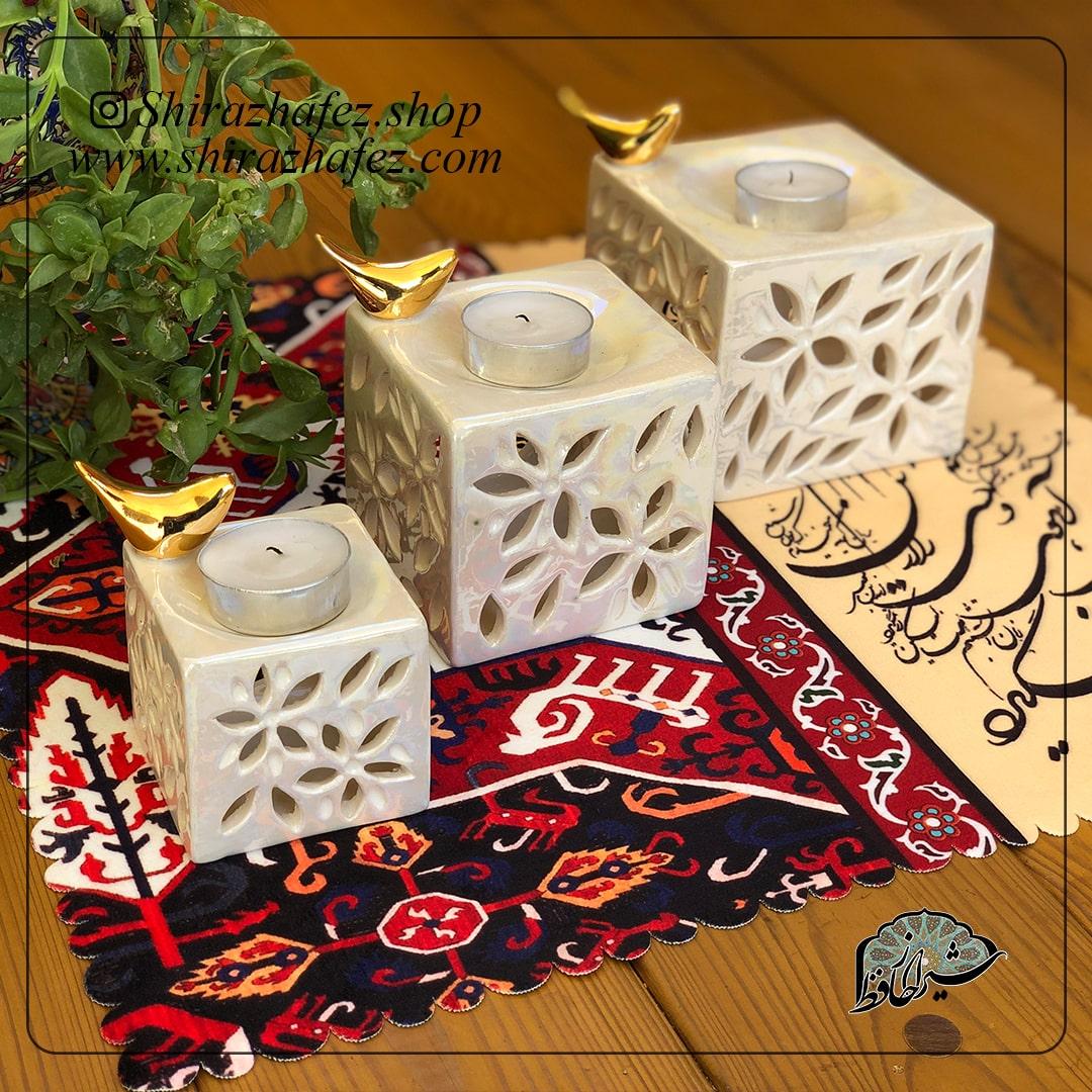 جاشعمی مکعبی لاستر طلا از جنس سرامیک و لعاب دار . یکی از محصولات فروشگاه آنلاین صنایع دستی شیراز حافظ ، که هم جنبه ی زینتی دارد و هم میتواند مورد